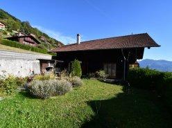 Chalet sympa avec magnifique vue, deux terrasses, un gran séjour avec cheminée