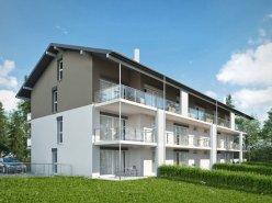 FOTI IMMO - Appartement neuf de 2,5 pièces avec jardin.